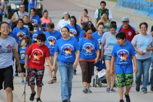 Shelley Means walks with her twin sons in Mission on April 30, 2014. Click on the link below to watch the students of Rosebud Elementary walk for Autism Awareness.