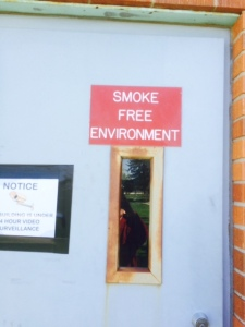 "The Rosebud Sioux Tribal Building has red signs posted at the entrances declaring the building a ""Smoke Free Environment"" yet employees are allowed to smoke inside the furnace room."